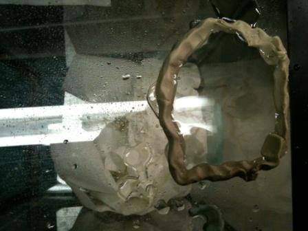 Note the ring of plumbers putty and the water inside the ring